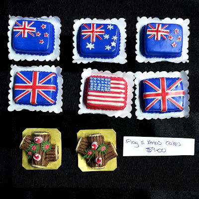 One-twelfth scale dolls house cakes decorated with flags of Australia, New Zealand, Britain or The United States.