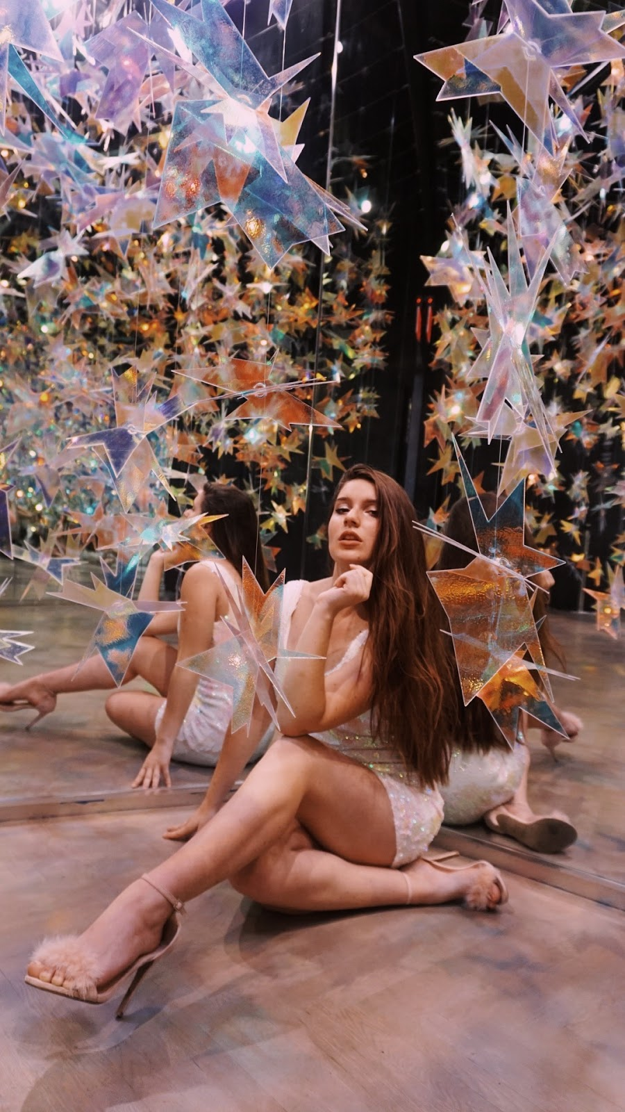 girl sitting in star art exhibit in Galeria Melissa NYC