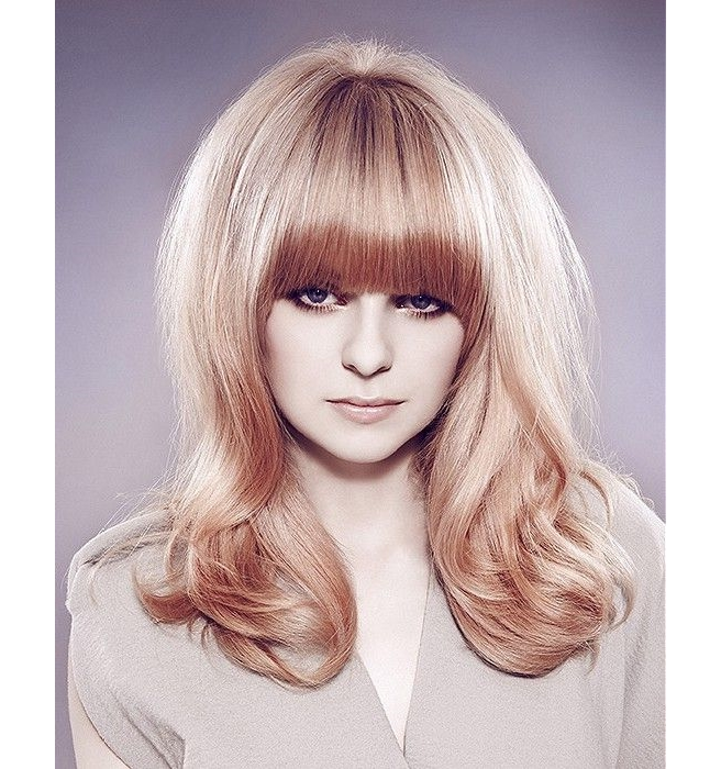 long blonde hairstyle with blunt bangs, sixties style