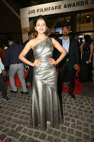 Rakul Preet Singh in Shining Glittering Golden Half Shoulder Gown at 64th Jio Filmfare Awards South ~  Exclusive 051.JPG