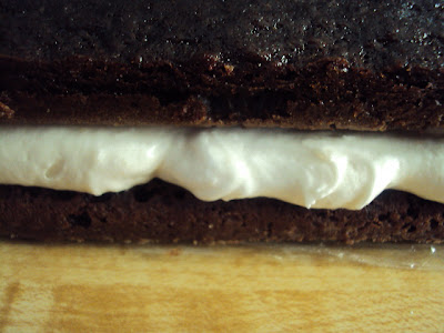 Chocolate filled cake with creamy frosting; a large Gob Cake or Whoopie Pie