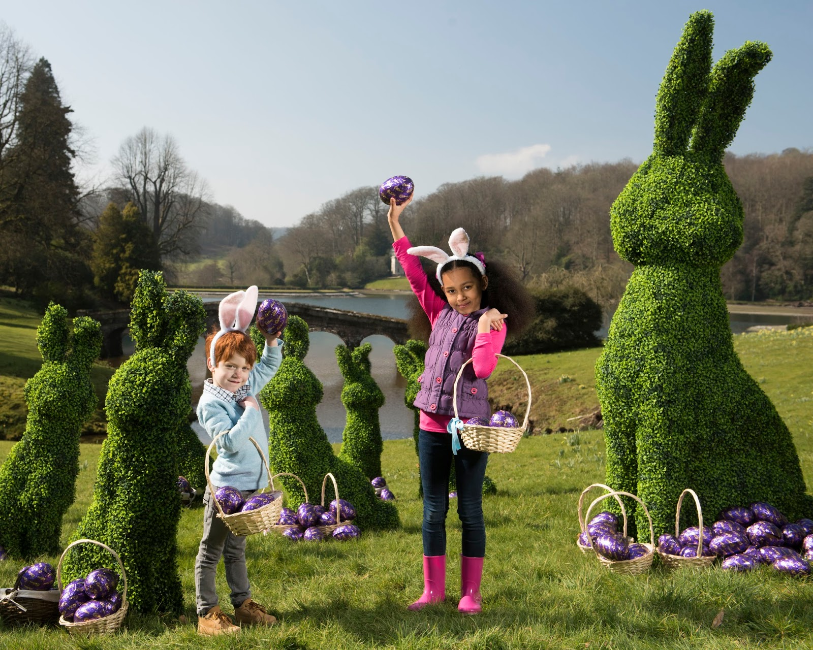 Children with the topiary Easter bunny at Stourhead for National Trust - motherdistracted.co.uk