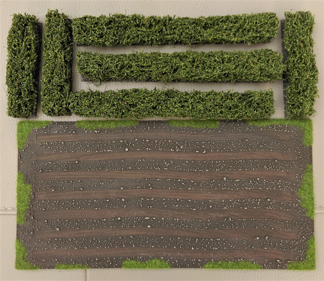 Magnetic Displays painted ploughed field and hedges