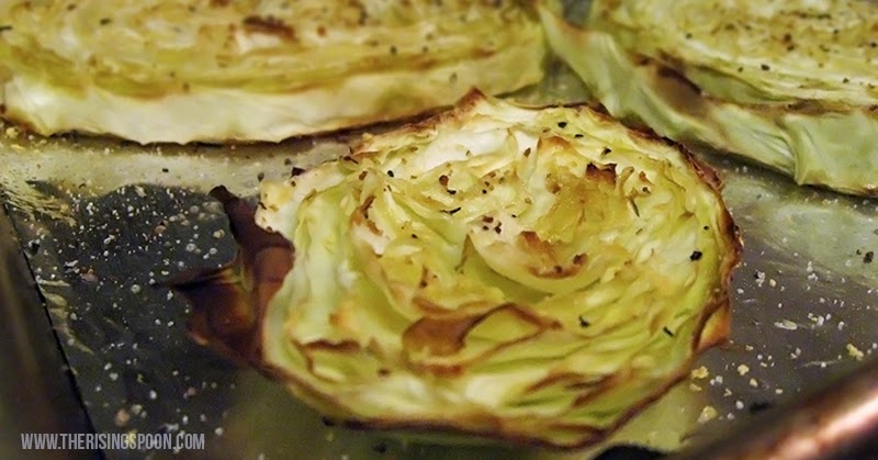 Soft, sweet and caramelized cabbage rounds brightened with lemon juice and spiced with garlic and nutritional yeast make a simple, tasty, frugal and vegan friendly side dish recipe perfect for any meal.