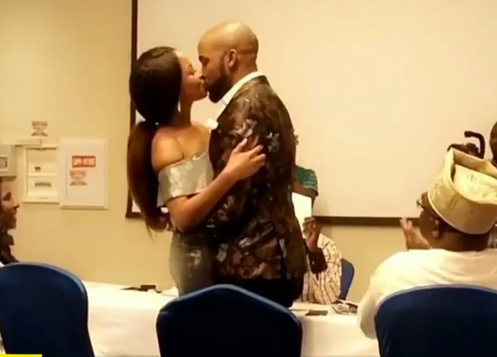 Adesua Etomi and Banky W kiss passionately as they legally tie the knot