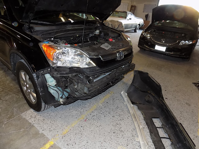 Collision Damage on Honda CR-V before repairs at Almost Everything Auto Body