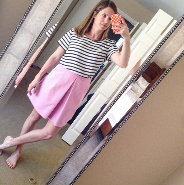 striped top and pink skirt