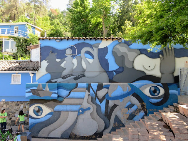 "Blue and gray street art resembling a Picasso painting outside Pablo Neruda's house ""La Chascona"" in Santiago Chile"