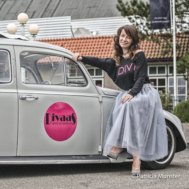 Manja in front of VW beetle, wearing a tulle skirt