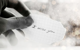 white paper piece with i miss you written on it pic