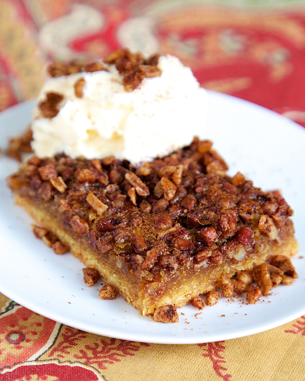 Gooey Pecan Bars - cake mix crust topped with yummy pecan pie filling. Serve warm with ice cream! Perfect for holiday meals! Everyone RAVES about this easy dessert recipe!