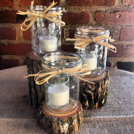 rustic wedding centerpiece with mason jars and lanterns