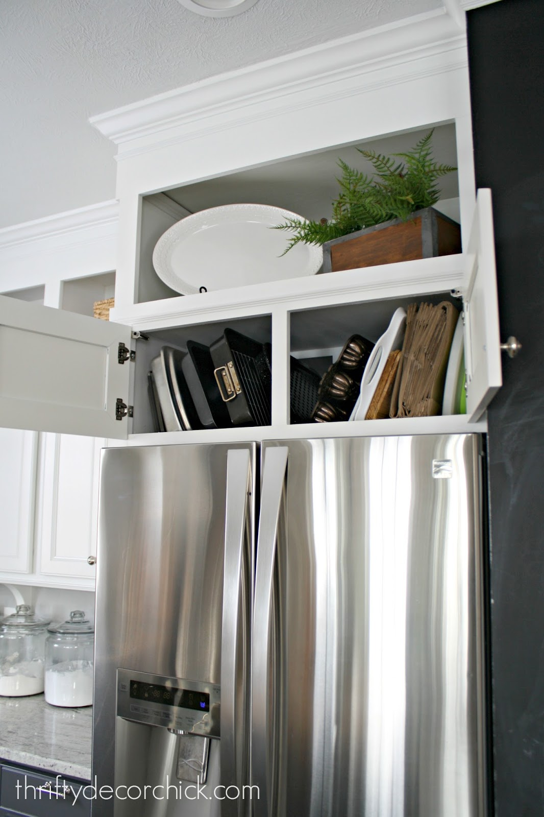 How Easily Organize Awkward Pans Above The Fridge From Thrifty Decor Chick