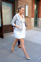 Blake Lively bares baby bump in tasselled mini dress