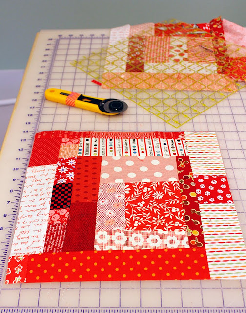 Wonky Log Cabin blocks all in red - link to tutorial to make the blocks