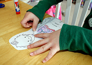 "After labeling, coloring and cutting out the various body systems from ""Putting It All Together,"" Tessa assembled the paper model and then explained how all of the systems work together. Quick note...I didn't see the value of having Tessa copy the lengthy system names for this particular activity, so I just cut them out from the list on the first page of the worksheet and had her paste them in the appropriate spots."