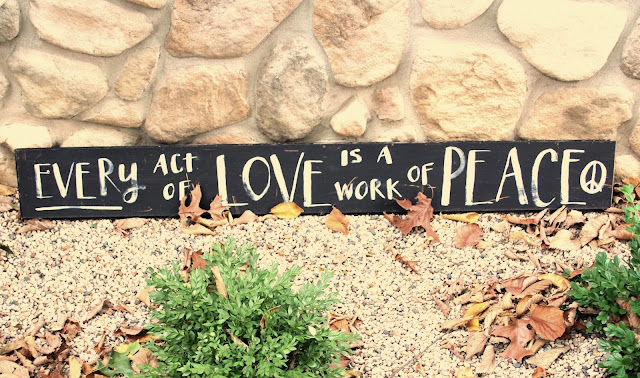 Every act of love is a work of peace - custom sign on Hello Lovely Studio.