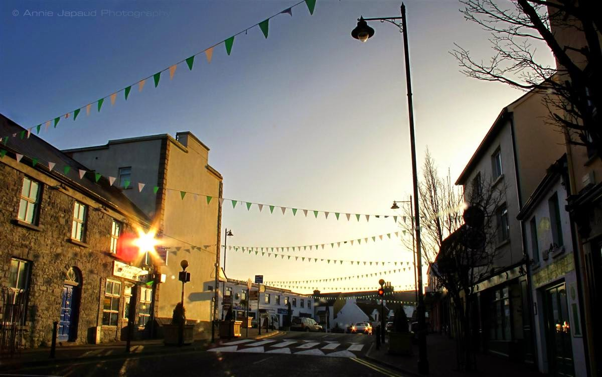 main street, Oughterard, sun-flare, sunrise, houses, passing cars