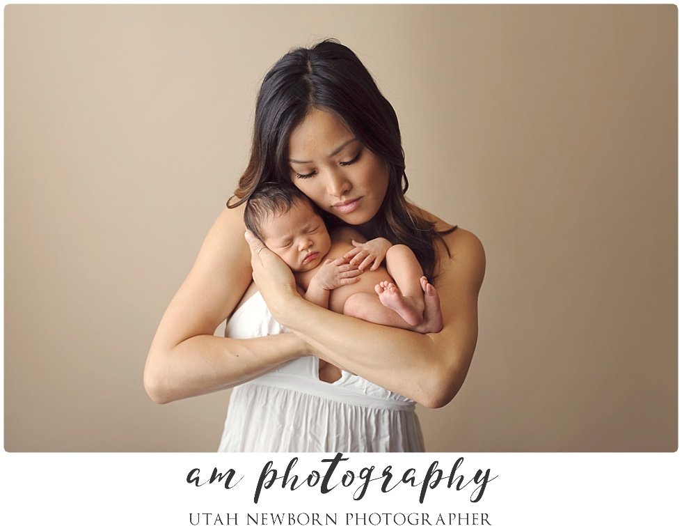 utah newborn photographed in mom's loving arms
