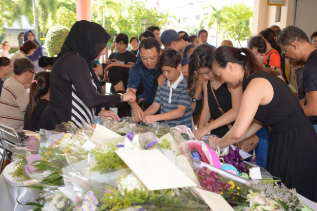 Even as Tanjong Katong Primary School (TKPS) mourned the deaths of six pupils and one teacher, other pupils, alumni, parents and staff gathered at a condolence site in the school porch to pen notes of remembrance.