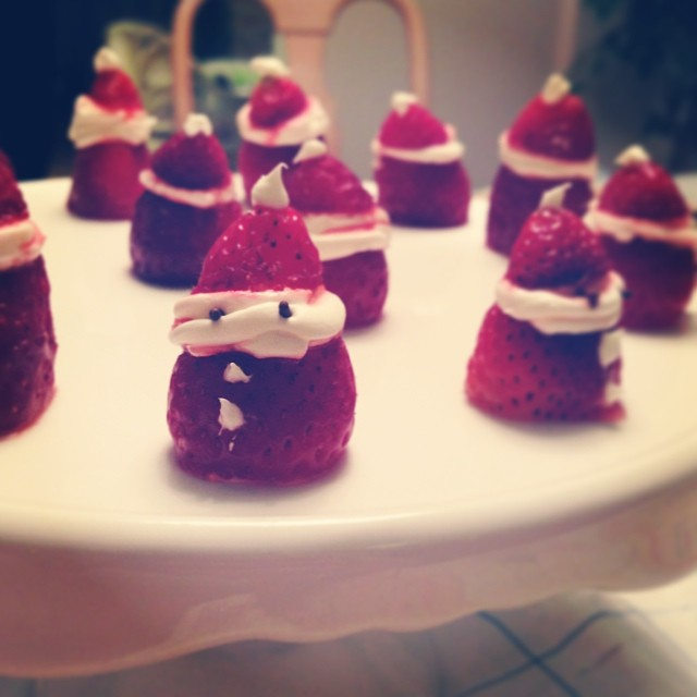 Playing with food - Christmas Strawberry Santas