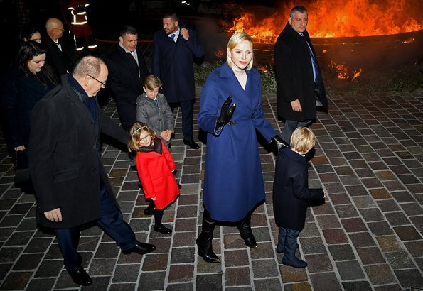 Prince Albert, Princess Charlene, Princess Gabriella and Prince Jacques attended Saint Devota event. royal blue cahmere wool coat