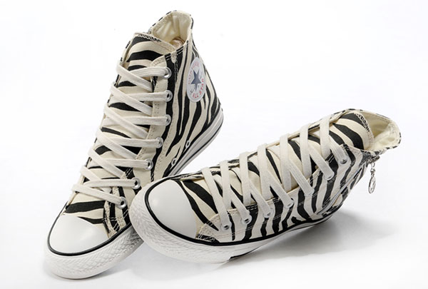 d02669706bc6 These zebra print Converse sport a side zipper with a unique star pull!
