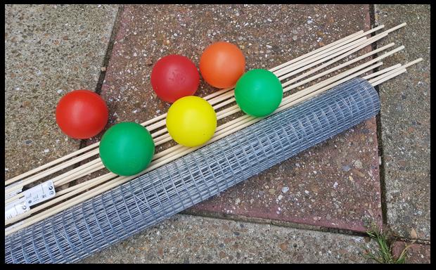 Basic materials needed to make Kerplunk.  Balls, sticks and mesh