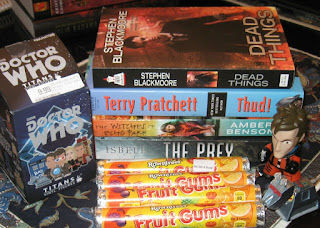 Dead Things by Stephen Blackmoore Thud by Terry Pratchett Witches of Echo Park by Amber Benson Prey by Tom Isbell