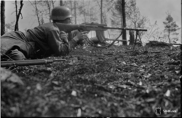 A Finnish soldier aiming an M/26 machine gun, 4 August 1941 worldwartwo.filminspector.com