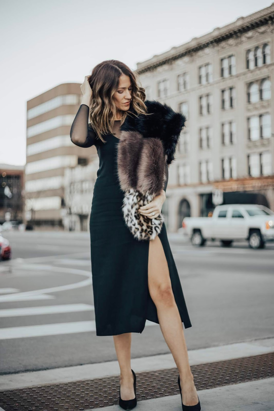 black slip dress with fur stole