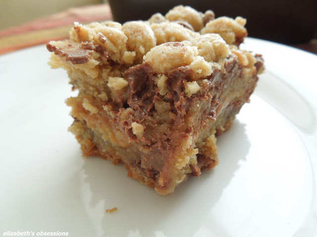 caramel stuffed chocolate chip cookie bar on a white plate