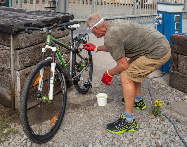 Photo of Phil painting oxcalic acid on his bike