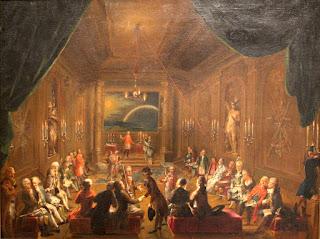 """Ceremonia de iniciación en la Logia Masónica vienesa, durante el reinado de José II, por Ignaz Unterberger (1748-1797). El cuadro presenta el interior de lo que se cree que es la logia """"Nueva esperanza coronada"""" (Zur Neugekrönten Hoffnung) en Viena. En su día se había considerado que Wolfgang Amadeus Mozart aparecía representado en el extremo derecho, sentado junto a su íntimo amigo Emanuel Schikaneder (1751-1812)."""