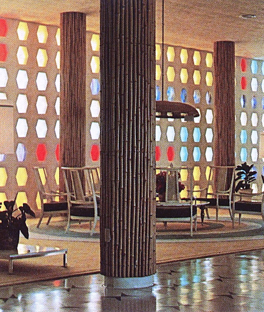bamboo covered columns in a 1950s hotel lobby, a color photograph