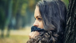 Beautiful Girl with Green Eyes looking away