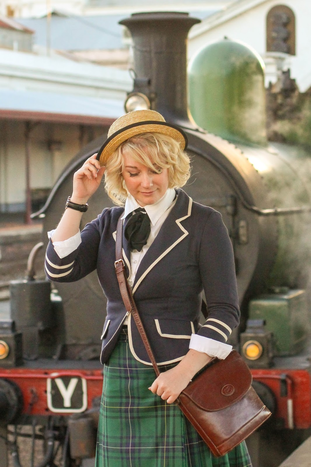 Liana of Finding Femme wears navy Modcloth Academia Ahoy blazer, black necktie, straw boater, green tartan school skirt at Ballarat Train Station for the steam train ride at Ballarat Heritage Weekend.