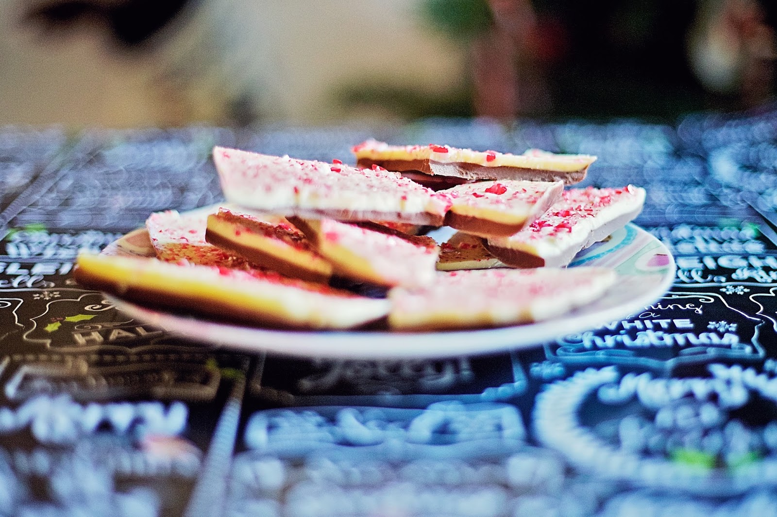 Close up on pieces of peppermint bark on a plate.