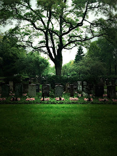photographs of graves in a cemetery on a rainy day by andreas warren matti