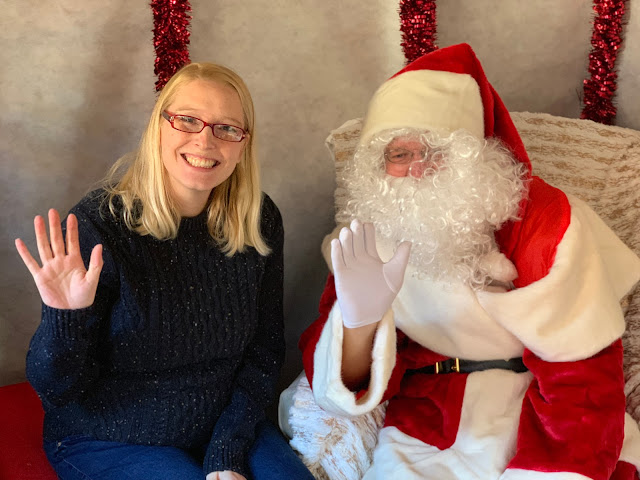 Father Christmas and I waving at the camera