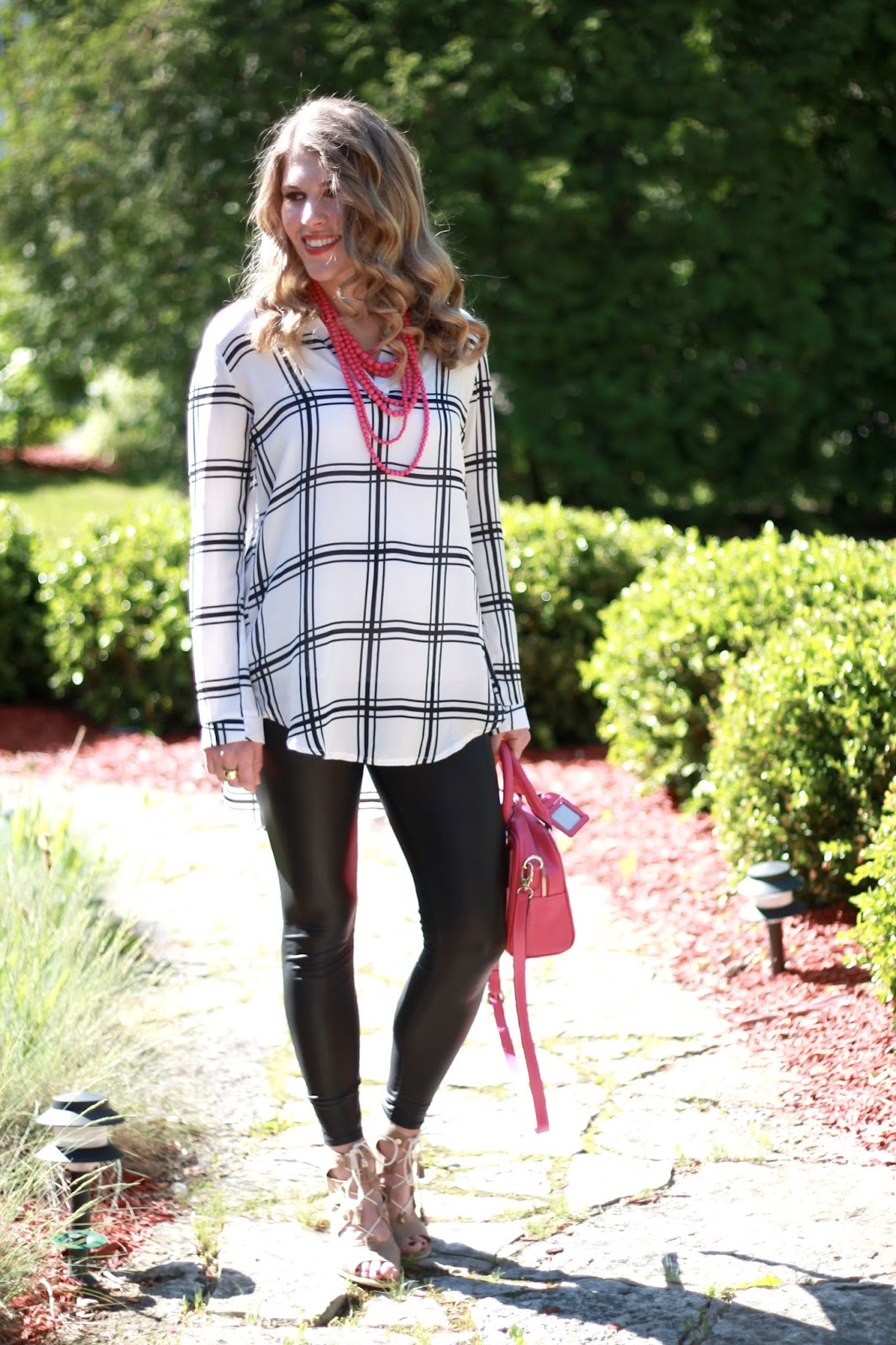 black and white plaid tunic, leather leggings, taupe lace up sandals. pink necklace, pink purse