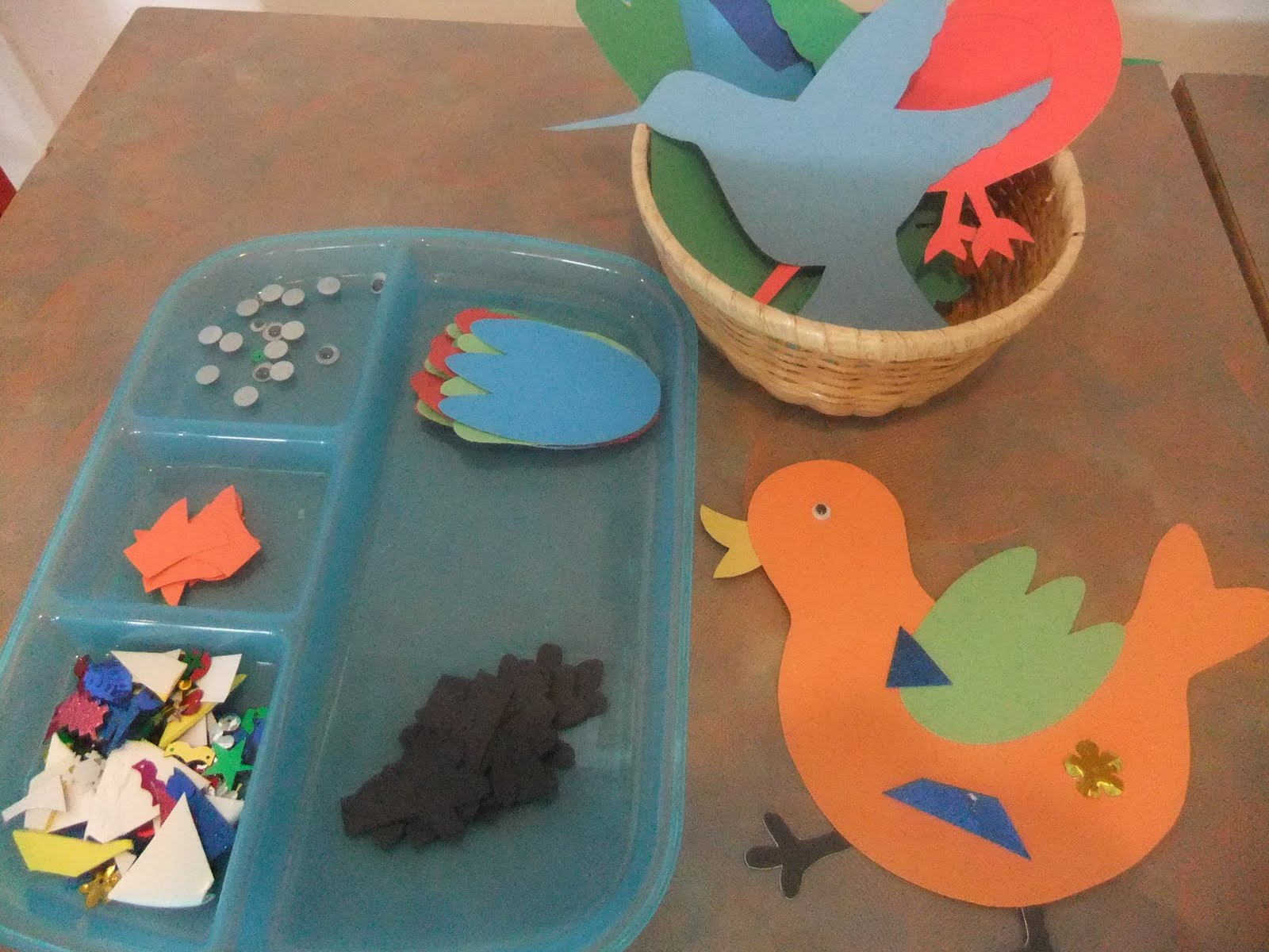 NAMC montessori preschool classroom activities learning about birds gluing craft