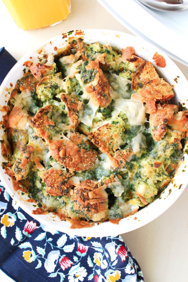 This Three Cheese Spinach Strata is a cheesy, french bread filled, make ahead egg casserole that makes a hearty breakfast or brunch.