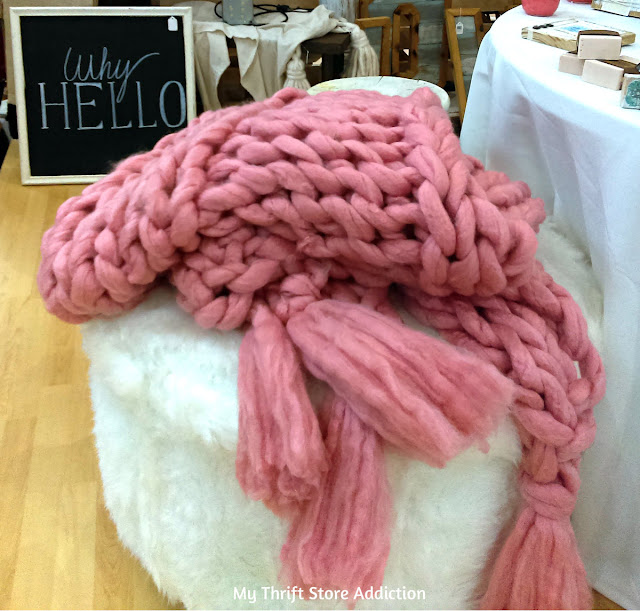 Shop local Chunky throw and fluffy pouf