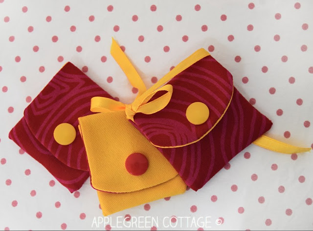 Learn how to make a mini pouch using small scraps of fabric. Tutorial by Apple Green Cottage