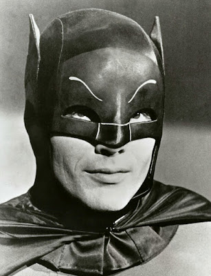 Portrait of Adam West in his Batman attire.