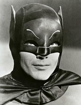 Portrait of Adam West in his Batman attire.