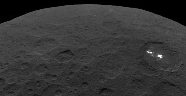 The bright spots of Occator Crater shine from the surface of Ceres. Research led by The University of Texas at Austin is helping reveal how the spots formed from cryomagma. Credit: NASA/JPL-Caltech/UCLA/MPS/DLR/IDA