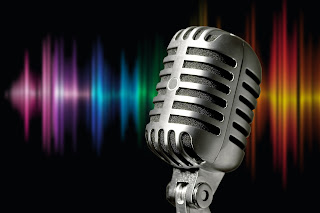 microphone with a rainbow background