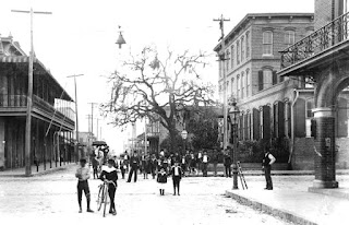 Youth stand in the street and on sidewalks in Ybor City at the turn of the 20th century